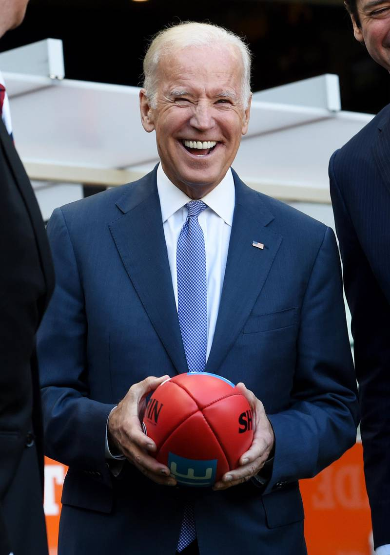 MELBOURNE, AUSTRALIA - JULY 17:  US Vice-President Joe Biden holds an AFL football as he speaks to the AFL CEO Gillon McLachlan and Mike Fitzpatrick before the round 17 AFL match between the Carlton Blues and the West Coast Eagles at the Melbourne Cricket Ground on July 17, 2016 in Melbourne, Australia. Biden is visiting Australia on a four day trip which includes a visit to Melbourne at the Victorian Comprehensive Cancer Centre to promote US-Australia cancer research and will host a round-table discussion with business leaders in Sydney. (Photo by Tracey Nearmy - Pool/Getty Images)