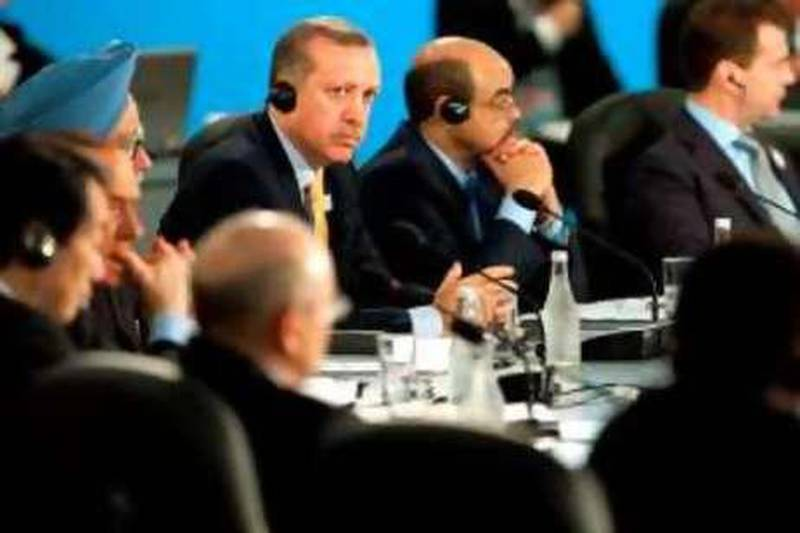 Turkish Prime Minister Tayyip Erdogan (C) attends the opening plenary session at the G20 Summit in Toronto, Ontario June 27, 2010.        REUTERS/Saul Loeb/Pool   (CANADA - Tags: POLITICS) *** Local Caption ***  WAS214_G20-_0627_11.JPG