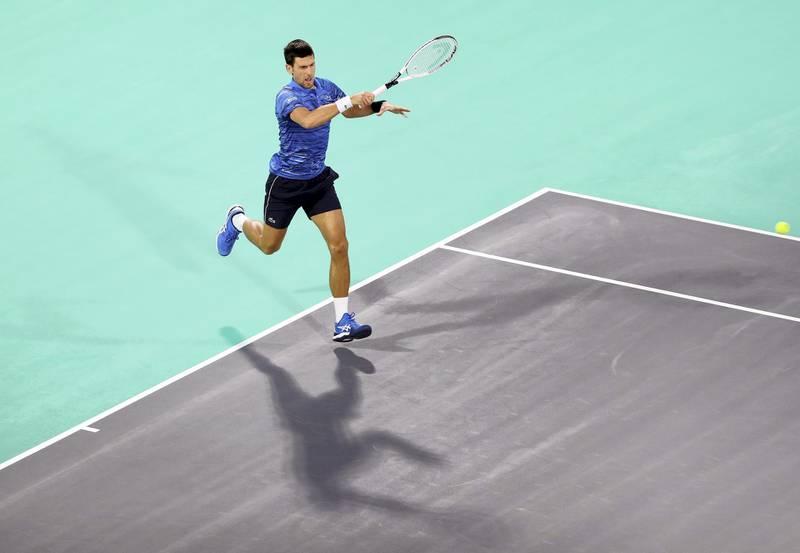 Abu Dhabi, United Arab Emirates - Reporter: Jon Turner: Novak Djokovic plays a shot during the third place play-off between Novak Djokovic v Karen Khachanov at the Mubadala World Tennis Championship. Saturday, December 21st, 2019. Zayed Sports City, Abu Dhabi. Chris Whiteoak / The National