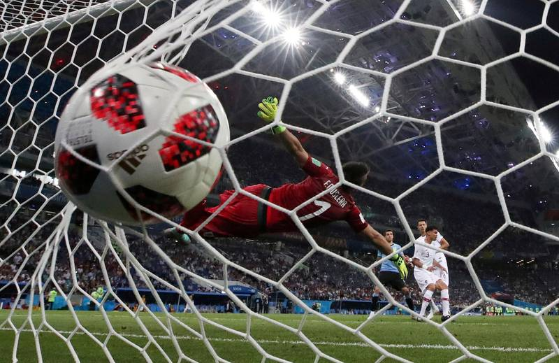 Soccer Football - World Cup - Round of 16 - Uruguay vs Portugal - Fisht Stadium, Sochi, Russia - June 30, 2018   Portugal's Pepe scores their first goal    REUTERS/Henry Romero     TPX IMAGES OF THE DAY