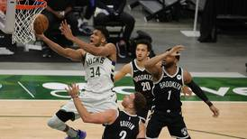 Giannis Antetokounmpo stars as Bucks seal place in play-offs