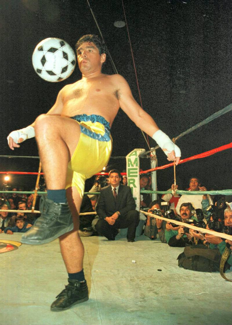 3 Apr 1996:  Soccer star Diego Maradona juggles a soccer ball in the ring at the end of a charity boxing match against Falucho Lacier, former WBA Flyweight world champion at the General Paz Junior's Club in Cordoba, Argentina.  The match, for which proceeds went to the club's soccer team, went the scheduled three rounds and was called a draw. Mandatory Credit: Ben Radford/ALLSPORT