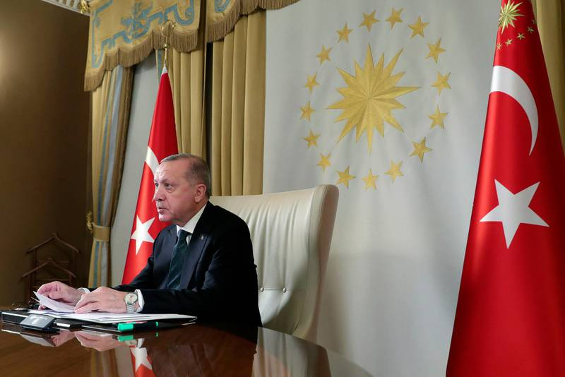 """Turkish President Recep Tayyip Erdogan participates in a teleconference with European leaders, in Istanbul, Tuesday, March 17, 2020.Erdogan has discussed """"opportunities for joint action"""" against the new coronavirus outbreak in a teleconference with the leaders of France, Germany and Britain, his office said Tuesday. The teleconference between Erdogan, German Chancellor Angela Merkel, French President Emmanuel Macron and British Prime Minister Boris Johnson was arranged after the European leaders cancelled plans to travel to Istanbul over the coronavirus crisis.(Presidential Press Service via AP, Pool)"""