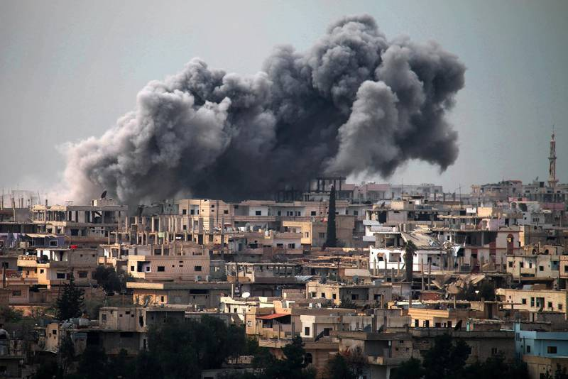 Smoke billows following reported air strikes on a rebel-held area in the southern city of Daraa, on March 16, 2017. - Daraa province, the cradle of the 2011 uprising against President Bashar al-Assad's regime, is mostly held by the rebels but pro-government forces and Islamic State are also present. (Photo by MOHAMAD ABAZEED / AFP)