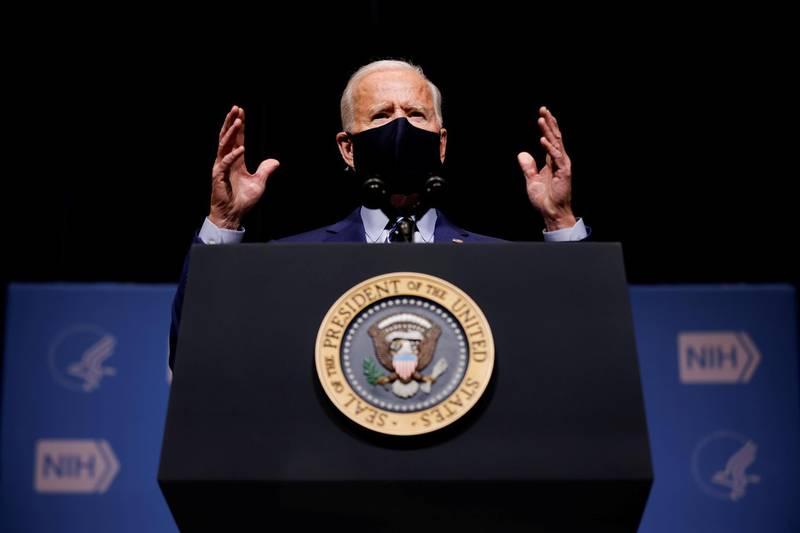 FILE PHOTO: U.S. President Joe Biden addresses National Institutes of Health (NIH) staff during a visit to NIH in Bethesda, Maryland, U.S., February 11, 2021. REUTERS/Carlos Barria/File Photo