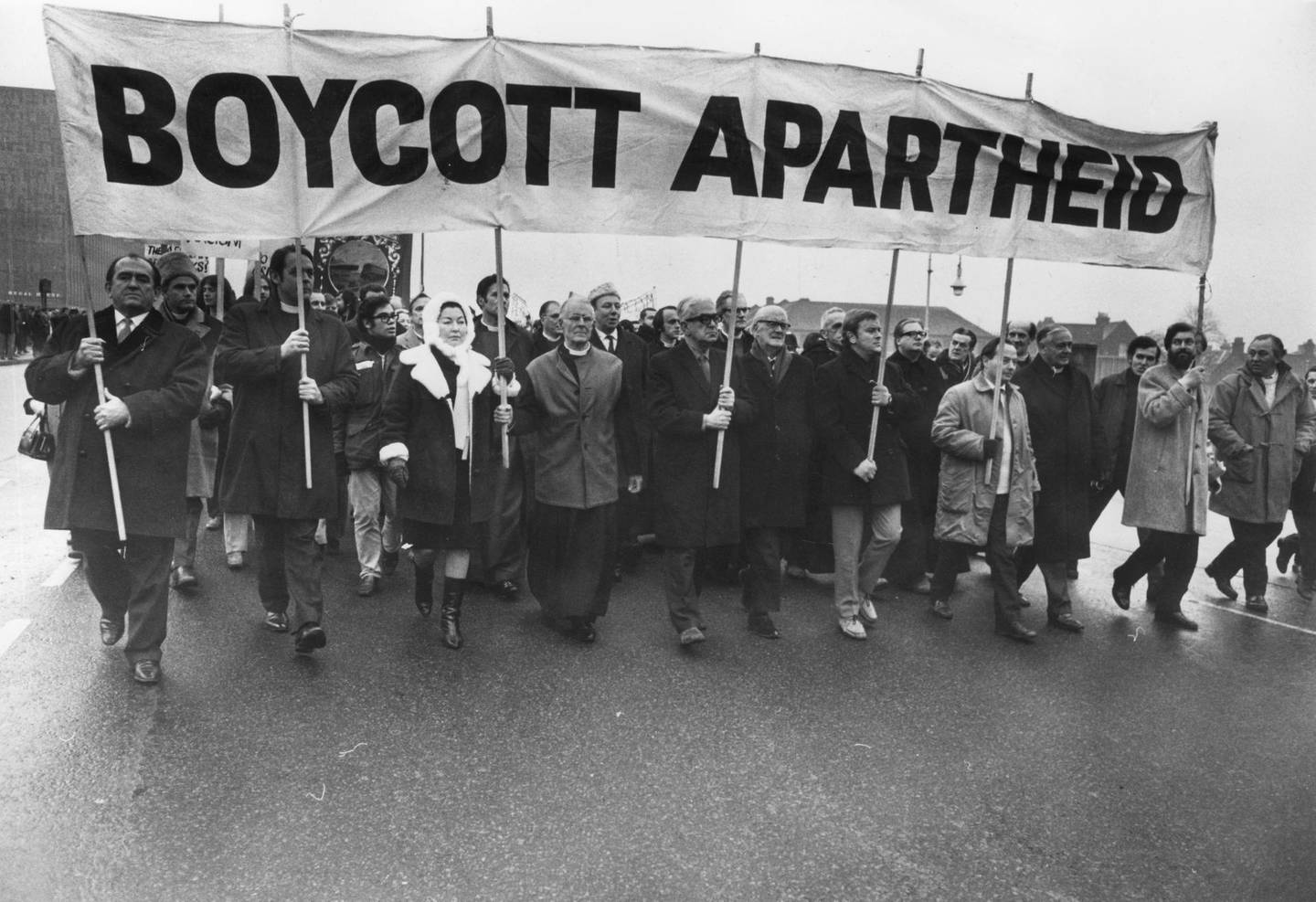 20th December 1969: Anti-apartheid marchers, including David Sheppard, Bishop of Woolwich (second left) and (from left) Anne Kerr MP, Methodist preacher and christian socialist Lord Donald Soper and Ian Mikardo MP, on their way to Twickenham rugby ground.   (Photo by Central Press/Getty Images)
