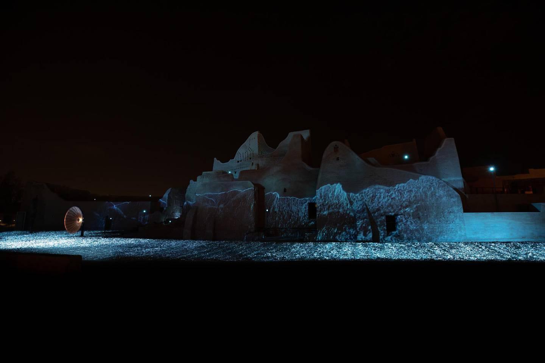 Robert Wilson PALACE OF LIGHT, 2021  Aluminium, copper disc, lights, video projection and music 10000 x 2500 cm Courtesy the artist Photo © Riyadh Art