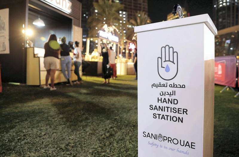 DUBAI , UNITED ARAB EMIRATES , December 18 – 2020 :- Hand sanitiser station installed at various points of the park at the Etisalat Market OTB at the Burj Park in downtown Dubai on the second day of the DSF opening concert in Dubai. ( Pawan Singh / The National ) For Arts & Culture/Online/Instagram. Story by Janice Rodrigues