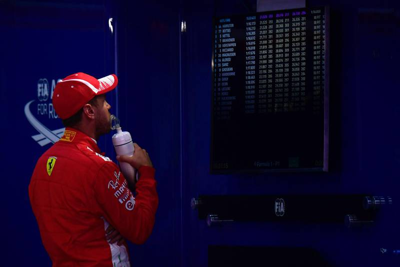 Ferrari's German driver Sebastian Vettel looks at the results after the qualifying session at the Circuit de Catalunya in Montmelo in the outskirts of Barcelona on May 12, 2018 ahead of the Spanish Formula One Grand Prix. / AFP / LLUIS GENE
