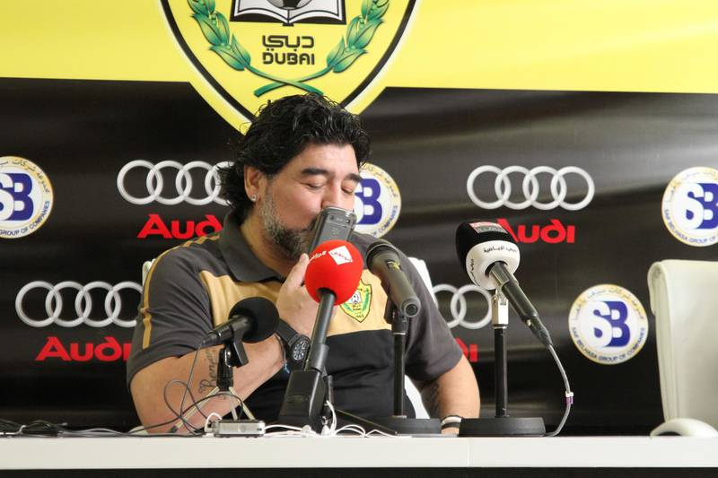 Diego Maradona kisses his phone when he took the call from grandson during the press conference. Courtesy Tariq Al-Sharabi