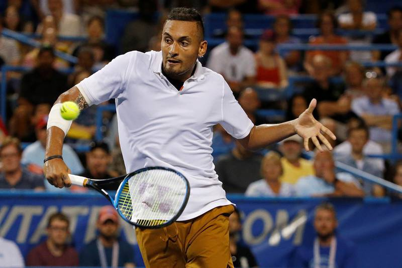 FILE PHOTO: Aug 3, 2019; Washington, D.C., USA; Nick Kyrgios of Australia hits a volley against Stefanos Tsitsipas of Greece (not pictured) in a menÕs singles semifinal of the 2019 Citi Open at William H.G. FitzGerald Tennis Center. Mandatory Credit: Geoff Burke-USA TODAY Sports/File Photo