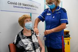 First woman to get Covid vaccine receives booster shot – and urges others to follow suit