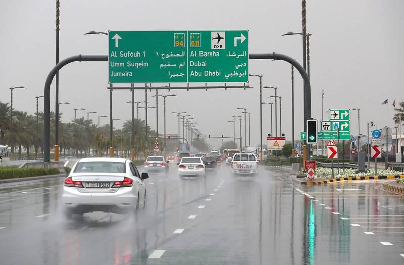 DUBAI, UNITED ARAB EMIRATES , March 22 – 2020 :- Traffic during the rain on King Salman Bin Abdulaziz Al Saud street in Dubai. (Pawan Singh / The National) For News/Online/Instagram.