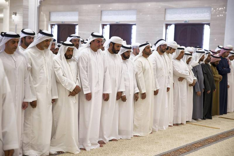AL AIN, ABU DHABI, UNITED ARAB EMIRATES - January 28, 2018: (L-R) HH Lt General Sheikh Saif bin Zayed Al Nahyan, UAE Deputy Prime Minister and Minister of Interior, HH Sheikh Khalifa bin Saif bin Mohamed Al Nahyan, Abdullah Saleh bin Badowah, HH Sheikh Mohamed bin Khalifa Al Nahyan, Abu Dhabi Executive Council Member, and other dignitaries, attend the funeral prayers of the late HH Sheikha Hessa bin Mohamed Al Nahyan, at Al Mutarad Grand Mosque. ( Mohamed Al Bloushi for Crown Prince Court - Abu Dhabi ) ---