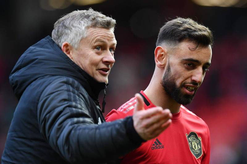 Manchester United's Portuguese midfielder Bruno Fernandes (R) and Manchester United's Norwegian manager Ole Gunnar Solskjaer (L) react as they leaves the pitch at the end of the English Premier League football match between Manchester United and Watford at Old Trafford in Manchester, north west England, on February 23, 2020. RESTRICTED TO EDITORIAL USE. No use with unauthorized audio, video, data, fixture lists, club/league logos or 'live' services. Online in-match use limited to 120 images. An additional 40 images may be used in extra time. No video emulation. Social media in-match use limited to 120 images. An additional 40 images may be used in extra time. No use in betting publications, games or single club/league/player publications.  / AFP / Paul ELLIS / RESTRICTED TO EDITORIAL USE. No use with unauthorized audio, video, data, fixture lists, club/league logos or 'live' services. Online in-match use limited to 120 images. An additional 40 images may be used in extra time. No video emulation. Social media in-match use limited to 120 images. An additional 40 images may be used in extra time. No use in betting publications, games or single club/league/player publications.