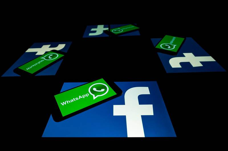 (FILES) This file photo taken on October 5, 2020 shows the logo of US social network Facebook and mobile messaging service WhatsApp on the screens of a smartphone and a tablet in Toulouse, southwestern France. Secure messaging app Signal is at the top downloads on Apple Store and Google Play platforms in several countries after the popular messaging app WhatsApp asked its some two billion users on January 7, 2021 to accept new terms that will allow it to share more information with its parent company Facebook and roll out advertising and e-commerce.  / AFP / Lionel BONAVENTURE