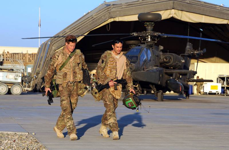 epa03549738 A picture dated 01 November 2012 shows Britain's Prince Harry (L) or just plain Captain Wales as he is known in the British Army, walks to his Helicopter with his fellow pilot at the British controlled flight-line in Camp Bastion, southern Afghanistan, where he served as an Apache Helicopter Pilot/Gunner with 662 Sqd Army Air Corps, from September 2012 for four months until January 2013. Prince Harry ended his five-month deployment in Afghanistan on 21 January 2013 with an admission during a BBC interview that he shot at Taliban insurgents as a co-pilot gunner in an Apache attack helicopter. He remarked: 'Take a life to save a life'.  EPA/JOHN STILLWELL / PA WIRE / POOL UK AND IRELAND OUT *** Local Caption ***  03549738.jpg