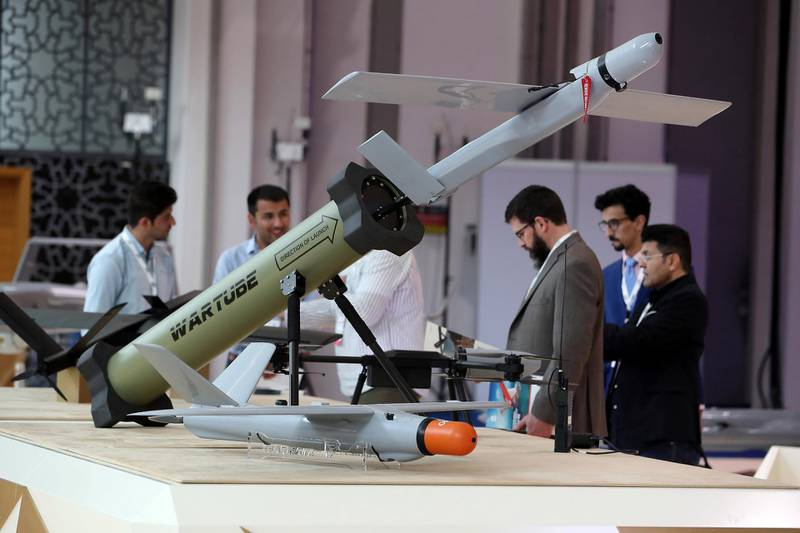 ABU DHABI, UNITED ARAB EMIRATES , Feb 23  – 2020 :- Visitors looking drones and unmanned ground vehicle which is on display at the International Golden Group stand on the first day of the UMEX & SimTEX held at Abu Dhabi National Exhibitions Centre in Abu Dhabi. (Pawan  Singh / The National) For News/Online/Instagram.  Story by Kelsey Warner