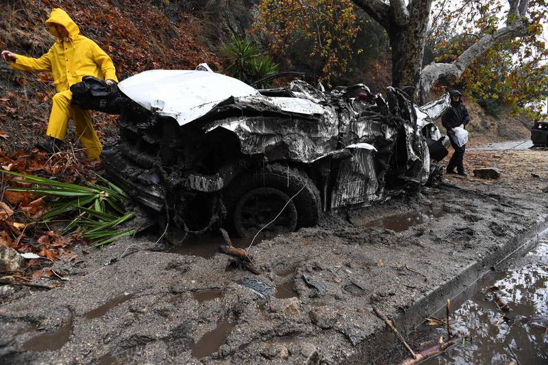 Mud fills a street after a rain-driven mudslide destroyed two cars and damaged property in a neighborhood under mandatory evacuation in Burbank, California, January 9, 2018. Mudslides unleashed by a ferocious storm demolished homes in southern California, authorities said Tuesday. Five people were reported killed. / AFP PHOTO / Robyn Beck