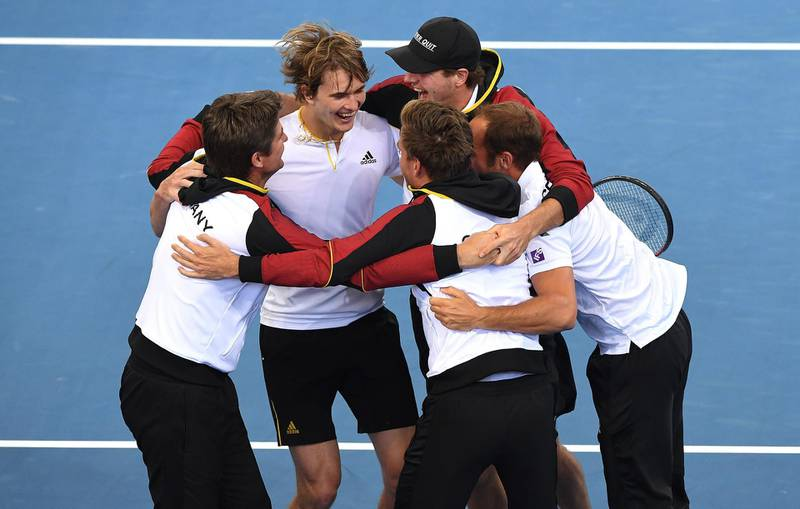 epa06495011 Alexander Zverev of Germany (2-L) reacts with his team after defeating Nick Kyrgios of Australia during the World Group first round match of the Davis Cup between Australia and Germany at the Pat Rafter Arena in Brisbane, Queensland, Australia, 04 February 2018.  EPA/DAVE HUNT  AUSTRALIA AND NEW ZEALAND OUT