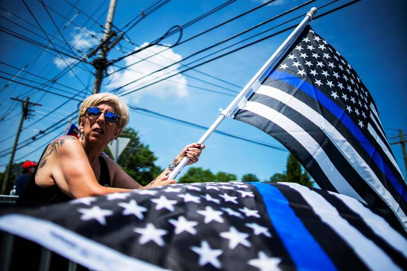 A woman takes part in a rally to support U.S. President Donald Trump and the Back the Blue in Bedminster, New Jersey, U.S., July 26, 2020. REUTERS/Eduardo Munoz