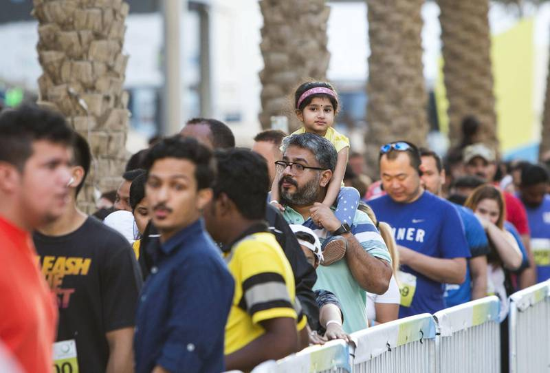 Dubai, United Arab Emirates - Participants from all walks of life at the starting line at the Dubai 30x30 Run at Sheikh Zayed Road.  Leslie Pableo for The National