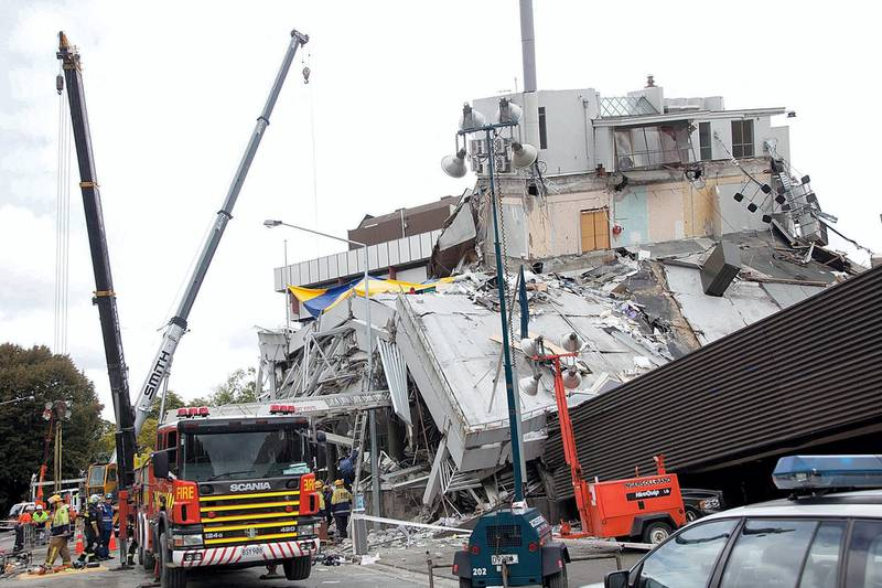 Rescuers working at the site of the collapsed Pyne Gould Corp (PGC) building in Christchurch on February 23, 2011, a day after a 6.3 magnitude earthquake hit the city. AFP