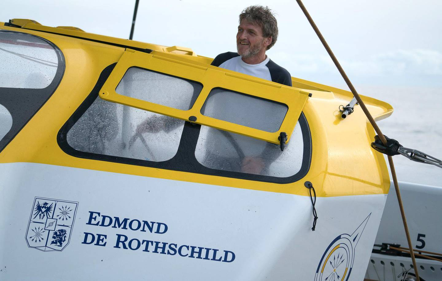 """This undated picture made available on January 16, 2021 by Gitana S.A press office shows Baron Benjamin de Rothschild at the helm of the Maxi Edmond de Rothschild. Baron Benjamin de Rothschild, chairman of the board of directors of Edmond de Rothschild Holding SA, the entity which oversees the Edmond de Rothschild Group, died on January 15, 2021, his family told AFP. - RESTRICTED TO EDITORIAL USE - MANDATORY CREDIT """"AFP PHOTO /Yann Riou / PolaRYSE / Gitana SA  """" - NO MARKETING - NO ADVERTISING CAMPAIGNS - DISTRIBUTED AS A SERVICE TO CLIENTS  / AFP / Yann Riou /polaRYSE / GITANA S.A / Yann Riou /polaRYSE / GITANA S.A / RESTRICTED TO EDITORIAL USE - MANDATORY CREDIT """"AFP PHOTO /Yann Riou / PolaRYSE / Gitana SA  """" - NO MARKETING - NO ADVERTISING CAMPAIGNS - DISTRIBUTED AS A SERVICE TO CLIENTS"""