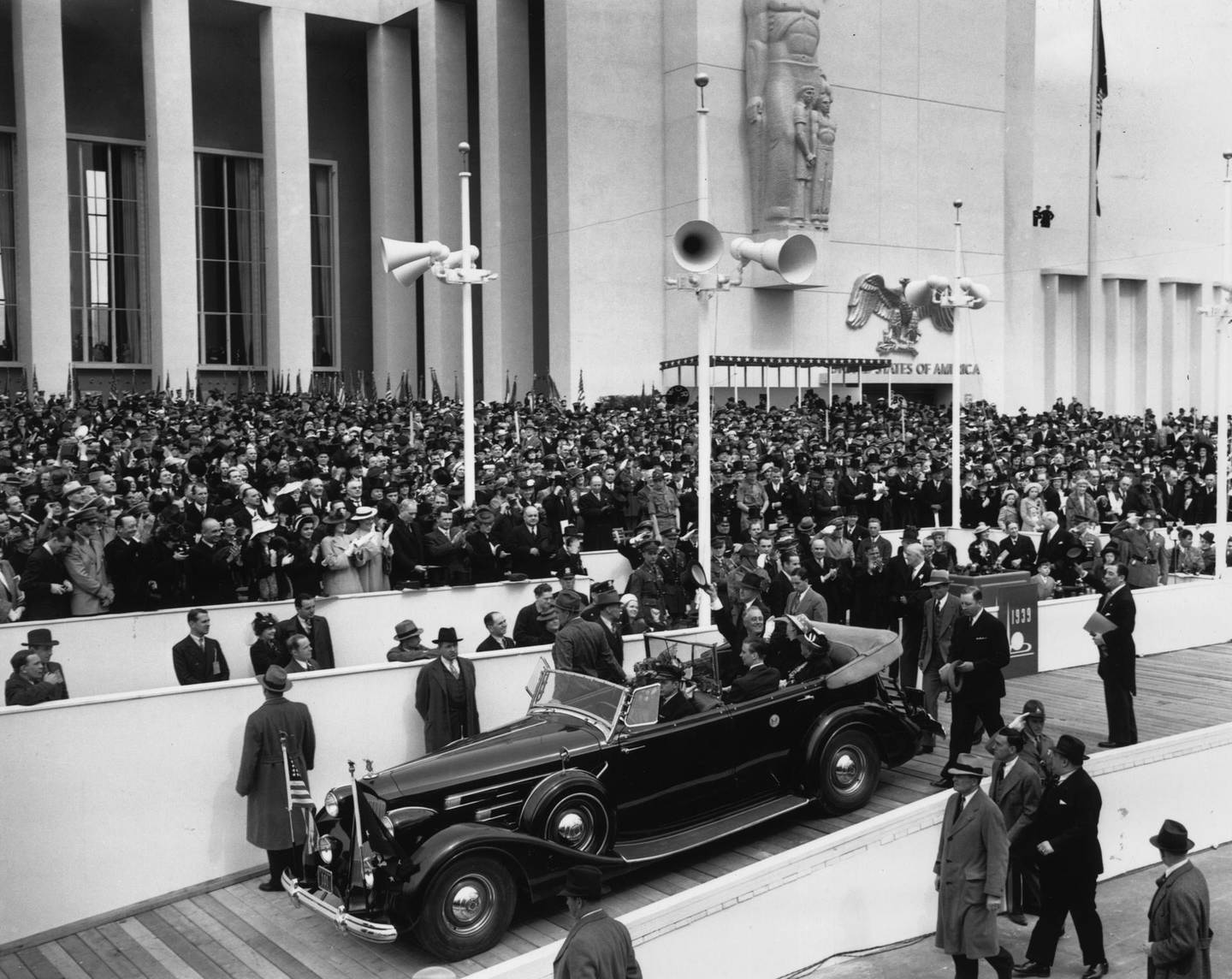 30th April 1939:  From his car drawn up at the entrance, President Roosevelt (1882 - 1945) waves to the crowds at the opening of the World Fair, New York.  (Photo by Fox Photos/Getty Images)