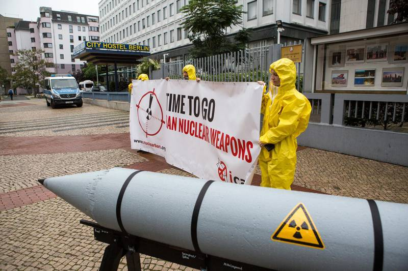 BERLIN, GERMANY - SEPTEMBER 13: International campaign to abolish Nuclear Weapons (ICAN) activists wearing yellow hazard suits are seen next to a Styrofoam effigy of a nuclear bomb after protesting in front of the North Korean Embassy on September 13, 2017 in Berlin, Germany. The protests, which were organized by anti-nuclear and pro-peace group ICAN, took place at both the North Korean and US embassies. (Photo by Omer Messinger/Getty Images)