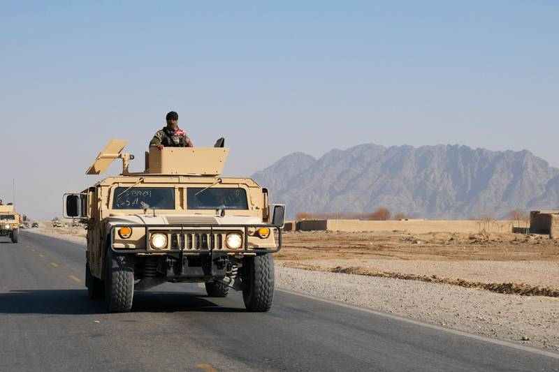 Pictured: A soldier observes from an armoured Humvee as part of an Afghan army convoy making its way along the highway to Herat.  Photo by Charlie Faulkner January 2021