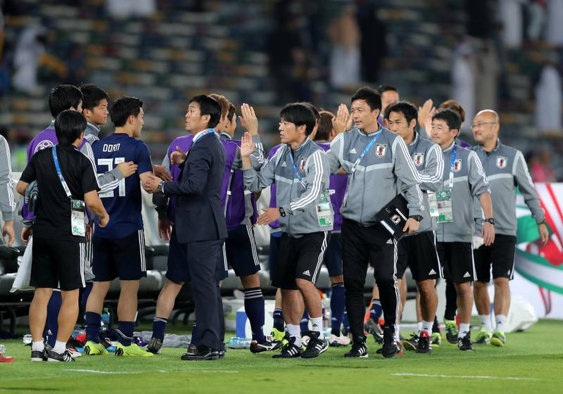 Abu Dhabi, United Arab Emirates - January 13, 2019: The Japan bench celebrates after the game between Japan and Oman in the Asian Cup 2019. Sunday, January 13th, 2019 at Zayed Sports City Stadium, Abu Dhabi. Chris Whiteoak/The National