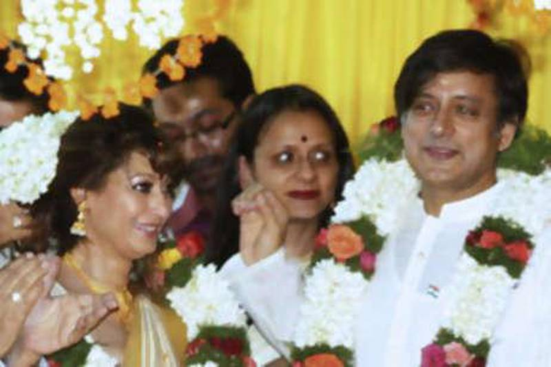 Indian parliamentarian Shashi Tharoor (R) and his bride Sunanda Pushkar Sunday (L) take part in their wedding ceremony in Pallakad on August 22, 2010.  Former UN diplomat Shashi Tharoor married long-time friend Sunanda Pushkar Sunday, months after the couple were the focus of a cricket team ownership scandal that saw him quit the Indian government. The couple were married in the presence of close relatives in Tharoor's ancestral home in the southern state of Kerala, a witness said.  AFP PHOTO/STR