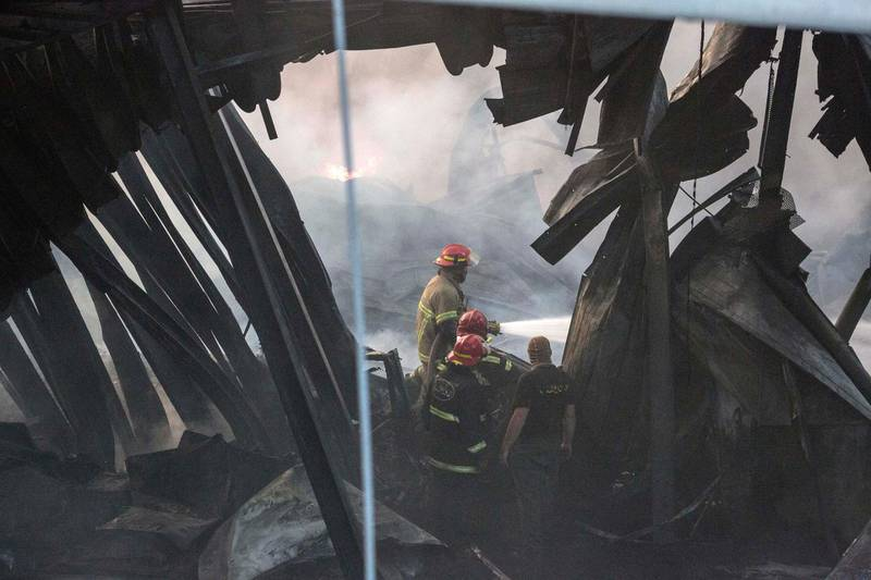 BEIRUT, LEBANON - SEPTEMBER 10: Firefighters walk through a burned out warehouse as they respond to a huge blaze at Beirut port on September 10, 2020 in Beirut, Lebanon. The fire broke out in a structure in the city's heavily damaged port facility, the site of last month's explosion that killed more than 190 people. (Photo by Sam Tarling/Getty Images)