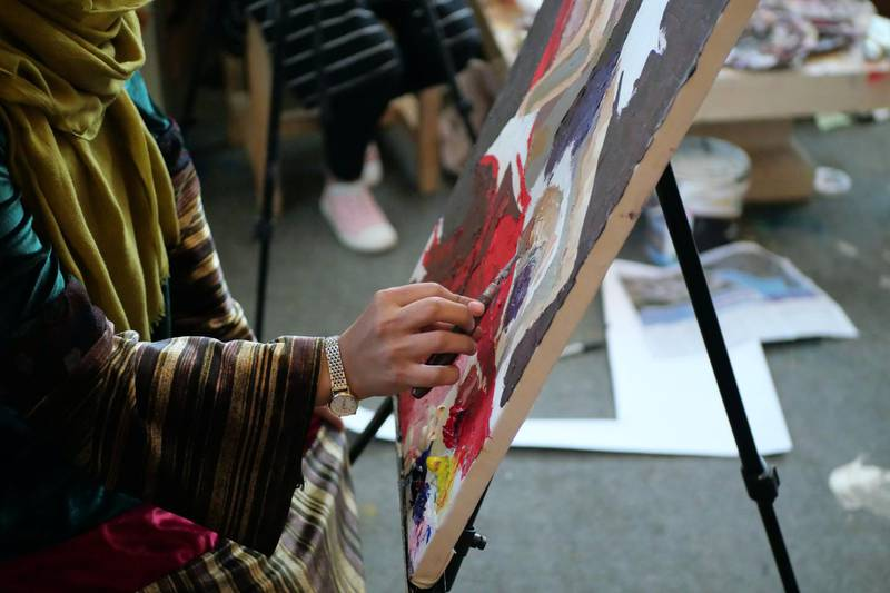 Pictured: Artists sit and paint at the ArtLords Kabul headquarters where they are able to receive training and mentoring.Photo by Charlie Faulkner February 2021
