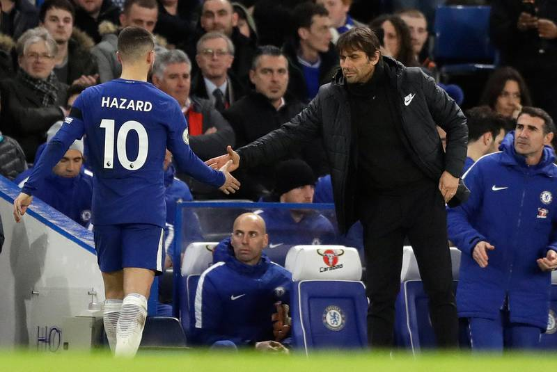 Chelsea's Eden Hazard shoes hands with Chelsea head coach Antonio Conte after being substituted during the English Premier League soccer match between Chelsea and Crystal Palace at Stamford Bridge stadium in London, Saturday, March 10, 2018. (AP Photo/Matt Dunham)