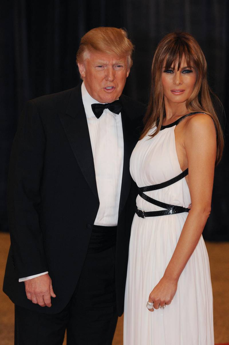 epa02711366 US business magnate Donald Trump (L) and his wife, Slovenian model Melania Trump (R), arrive for the White House Correspondents' Association (WHCA) Dinner in Washington DC, USA, 30 April 2011. The event is being attended by celebrity guests, US President Barack Obama and the First Lady and members of the Obama administration.  EPA/MICHAEL REYNOLDS