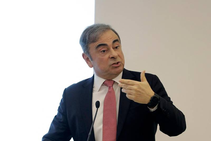Former Renault-Nissan boss Carlos Ghosn gestures as he addresses a large crowd of journalists on his reasons for dodging trial in Japan, where he is accused of financial misconduct, at the Lebanese Press Syndicate in Beirut on January 8, 2020. - The 65-year-old fugitive auto tycoon vowed to clear his name as he made his first public appearance at a news conference in Beirut since skipping bail in Japan. Ghosn, who denies any wrongdoing, fled charges of financial misconduct including allegedly under-reporting his compensation to the tune of $85 million. (Photo by JOSEPH EID / AFP)
