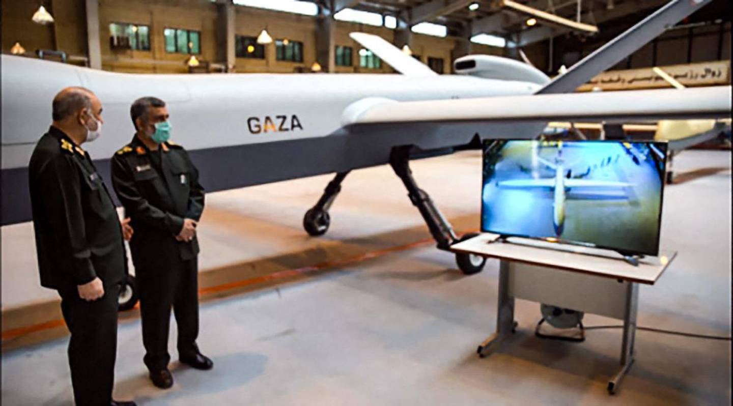 """This handout photo provided by Iran's Revolutionary Guard Corps (IRGC) official website via SEPAH News on May 21, 2021, shows General Hossein Salami (L) and Amir Ali Hajizadeh commander of Aerospace Force of the IRGC, unveiling a new combat drone called """"Gaza"""" in tribute to Palestinians, in the capital Tehran, hours after a ceasefire between Israel and Palestinian armed factions took effect. The drone is capable of carrying 13 bombs while flying at over 35,000 feet, with a speed of almost 350 kilometres per hour for 20 hours, Salami said.  - RESTRICTED TO EDITORIAL USE - MANDATORY CREDIT """"AFP PHOTO / Iran's Revolutionary Guard via SEPAH NEWS"""" - NO MARKETING - NO ADVERTISING CAMPAIGNS - DISTRIBUTED AS A SERVICE TO CLIENTS  / AFP / IRAN'S REVOLUTIONARY GUARDS WEBSITE / SEPAH NEWS / - / RESTRICTED TO EDITORIAL USE - MANDATORY CREDIT """"AFP PHOTO / Iran's Revolutionary Guard via SEPAH NEWS"""" - NO MARKETING - NO ADVERTISING CAMPAIGNS - DISTRIBUTED AS A SERVICE TO CLIENTS"""
