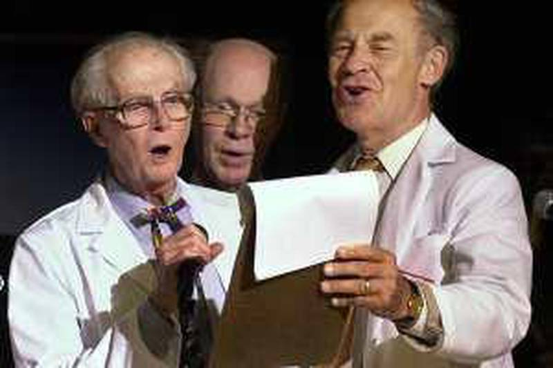 """Nobel Prize winners, from left, William Lipscomb (Chemistry '76), Robert Wilson (Physics '78) and Dudley Herschbach (Chemistry '86) join in song during the Ig Nobel awards ceremony Thursday, Oct. 4, 2001, in Cambridge, Mass. Each year in a spoof of the real Nobel Prize, the Ig Nobel Prizes are awarded by actual Nobel Prize winners at Harvard University for achievements that """"cannot or should not be reproduced."""" (AP Photo/Michael Dwyer)"""