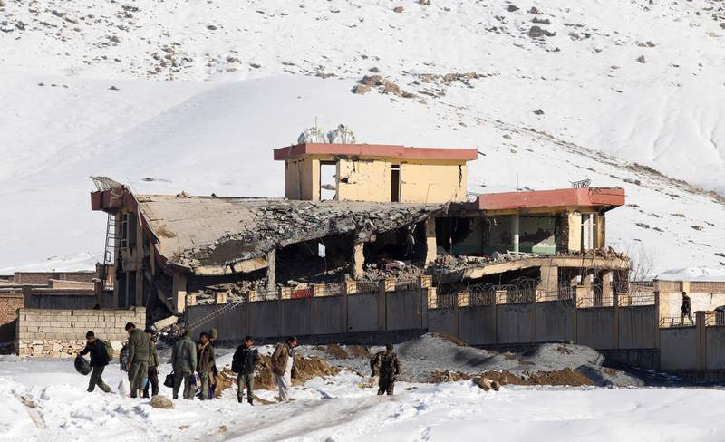 epaselect epa07306335 Afghan intelligence officers leave the collapsed building of Afghanistan's intelligence office following an attack in Wardak, Afghanistan, 21 January 2019. A Taliban Humvee tank full of explosive materials targeted the building with following attack of several other insurgents early in the morning.  According to the Afghan officials at least 18 officers were killed and 50 others wounded.  EPA/JAWAD JALALI