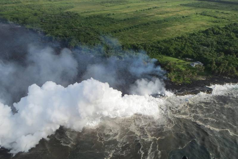 Hot lava entering the Pacific Ocean creates a dense white plume called 'laze', short for lava haze, in southeast of Pahoa, during ongoing eruptions of the Kilauea Volcano in Hawaii, U.S., May 20, 2018.   Picture taken May 20, 2018.   USGS/Handout via REUTERS    ATTENTION EDITORS - THIS IMAGE HAS BEEN SUPPLIED BY A THIRD PARTY.