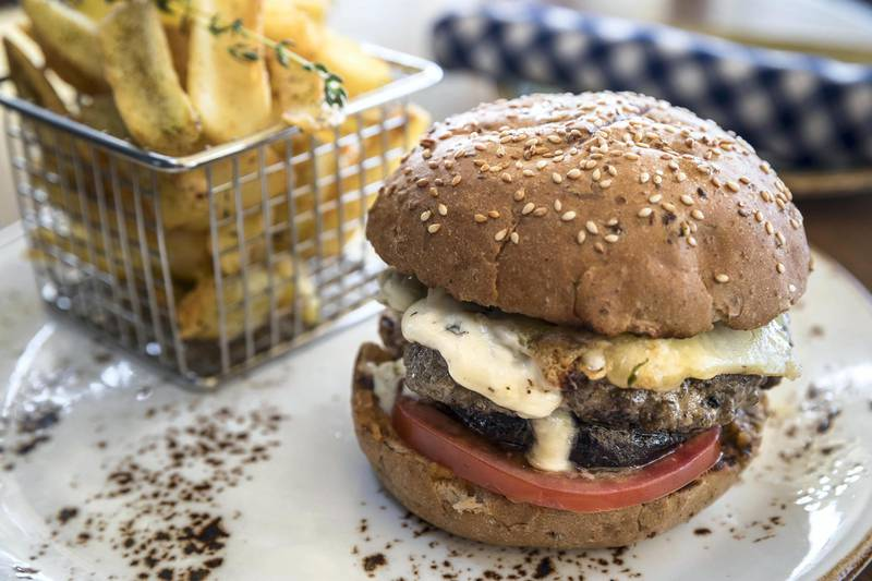 ABU DHABI, UNITED ARAB EMIRATES. 28 MARCH 2018. Chef Theodoro Rouvas, Head Chef at Eat Greak in the Galleria Mall prepares a Moussaka Burger. (Photo: Antonie Robertson/The National) Journalist: Melinda Healy. Section: Weekend.