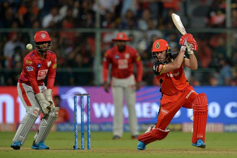 Royal Challengers Bangalore batsman AB De Villiers (R) plays a shot while Kings XI Punjab wicketkeeper Nicholas Pooran (L) looks on during the 2019 Indian Premier League (IPL) Twenty20 cricket match between Royal Challengers Bangalore and Kings XI Punjab at The M. Chinnaswamy Stadium in Bangalore on April 24, 2019. (Photo by Manjunath KIRAN / AFP) / ----IMAGE RESTRICTED TO EDITORIAL USE - STRICTLY NO COMMERCIAL USE-----