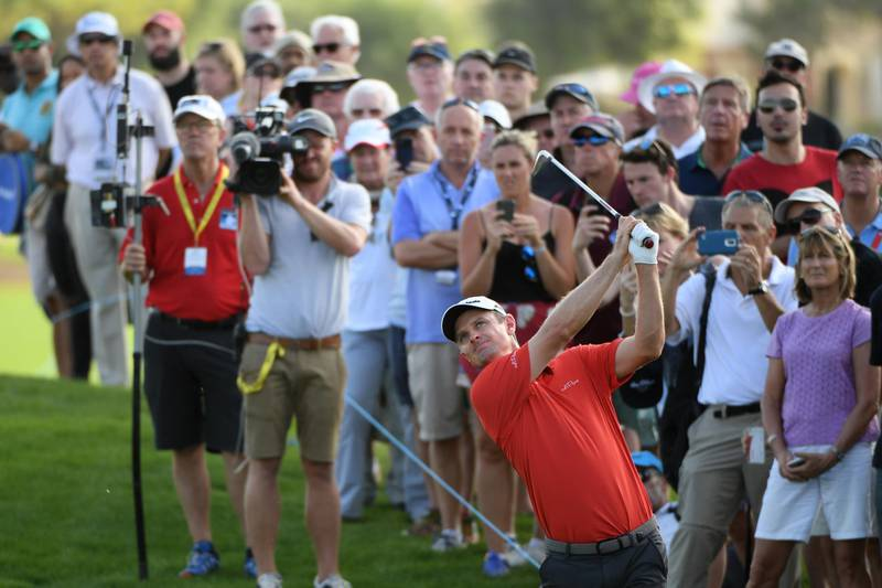 DUBAI, UNITED ARAB EMIRATES - NOVEMBER 18:  Justin Rose of England hits his second shot on the 12th hole during the third round of the DP World Tour Championship at Jumeirah Golf Estates on November 18, 2017 in Dubai, United Arab Emirates.  (Photo by Ross Kinnaird/Getty Images)