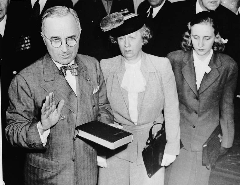 Harry S. Truman (1884 - 1972) takes the oath at the start of his term of office as the 33rd president of the United States. Standing beside him are his wife Bess and daughter Margaret.   (Photo by Central Press/Getty Images)