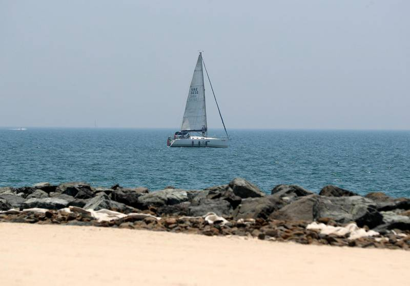 Dubai, United Arab Emirates - Reporter: N/A: News. A sail boat at Kite surfing beach as beaches in Dubai re open. Friday, May 29th, 2020. Dubai. Chris Whiteoak / The National