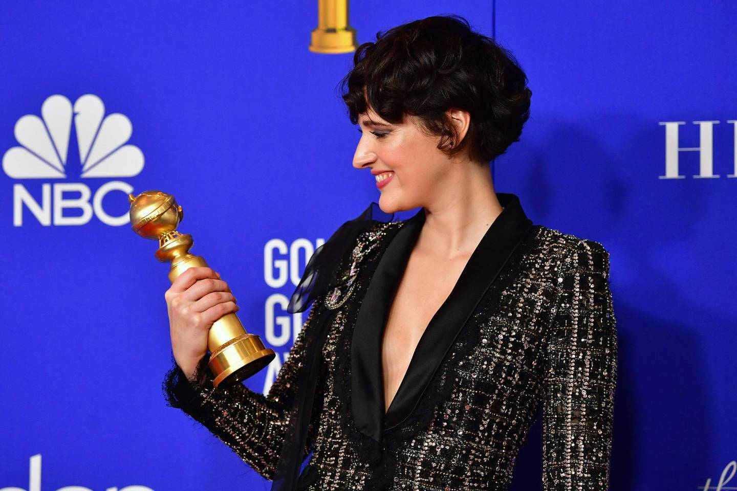 TOPSHOT - British actress Phoebe Waller-Bridge poses in the press room with the award for Best Performance by an Actress in a Television Series - Musical or Comedy during the 77th annual Golden Globe Awards on January 5, 2020, at The Beverly Hilton hotel in Beverly Hills, California. / AFP / FREDERIC J. BROWN