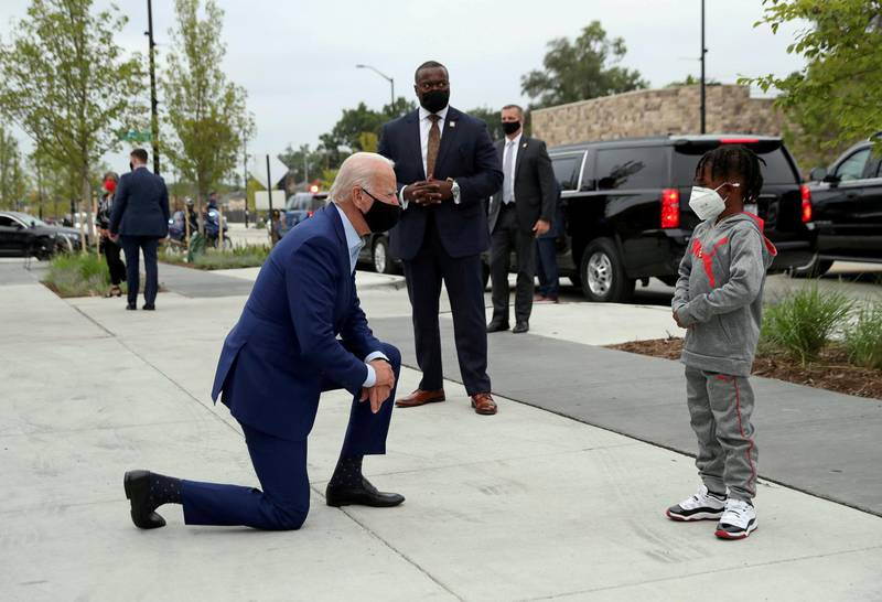 """Democratic U.S. presidential nominee and former Vice President Joe Biden speaks to CJ Brown as he makes a brief stop at """"Three Thirteen"""" clothing store to buy a few items for his grandchildren while visiting Detroit, Michigan, September 9, 2020. REUTERS/Leah Millis     TPX IMAGES OF THE DAY"""