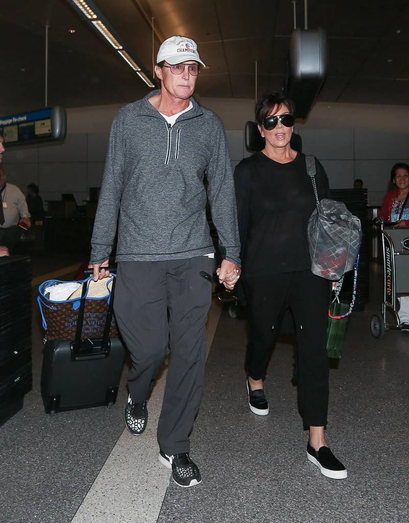 LOS ANGELES, CA - APRIL 02: Bruce Jenner and Kris Jenner are seen at LAX on April 02, 2014 in Los Angeles, California.  (Photo by GVK/Bauer-Griffin/GC Images)